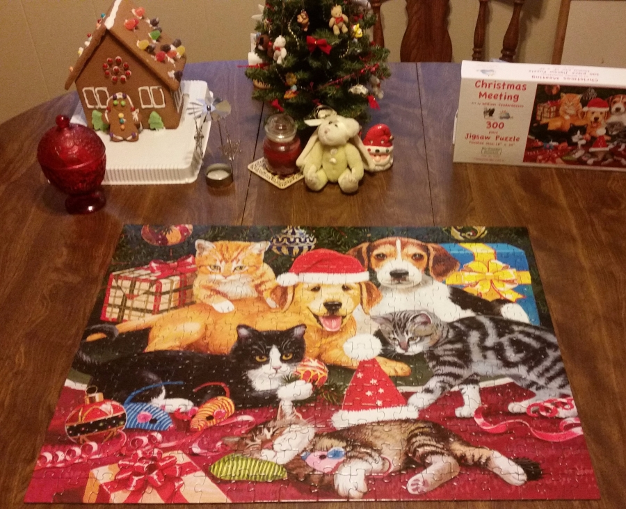 Christmas puzzle, gingerbread house, and tree centerpiece on my kitchen table