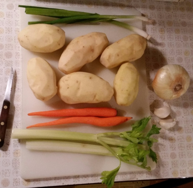 6 potatoes, 2 carrots, 1 1/2 stalks of celery, 2 green onions, half of a yellow onion, and 2 cloves of garlic